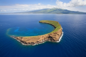 That's Molokini, off Maui, not hard to tell it's an ancient volcano cone now barely above the water