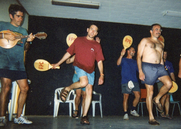 Paddle tennis meets Riverdance: that's me (on mandolin), Randy in red, and Michel beside him, inexplicably shirtless.