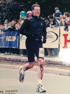 At the finish of the 2003 Toronto marathon: Chris is hurting in more ways than one.